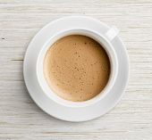 stock photo of scum  - coffee cup with foam  on table top view - JPG