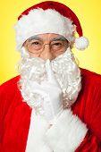 Shh...aged Santa Gesturing Silence