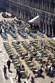 Ourists On San Marco Square Feed Large Flock Of Pigeons