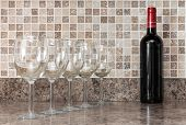 Bottle Of Wine And Glasses On Kitchen Countertop