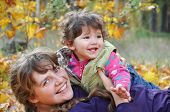 Mom Plays With Her Daughter, Dabbles In The Autumn Forest