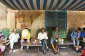 People at sidewalk coffee
