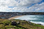 Porthmeor beach St Ives Cornwall England by the Tate Art Gallery with white waves breaking