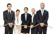 Group of business people tied with rope and their mouths are taped , isolated on white. Concept of r