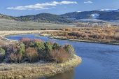 meanders of North Platte River above North Gate Canyon near Cowdrey, Colorado, in a fall scenery wit