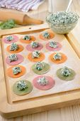 Cooking multi-colored ravioli with spinach and ricotta