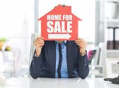 Realtor Woman Holding Home For Sale Sign In Front Of Face