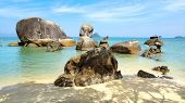 stock photo of langkawi  - Giant boulders at Black Sand Beach - JPG