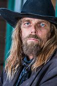stock photo of bandit  - Portrait of a gruff looking old west bandit - JPG