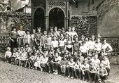 POLAND, CIRCA 1970's: Vintage photo of group of classmates and teachers posing together  during a sc
