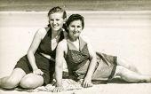 POLAND, CIRCA 1940's: Vintage portrait of two women on beach