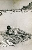 POLAND, CIRCA 1940's: Vintage portrait of woman on beach