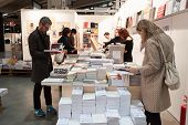 People Visiting Bookstore At Miart 2014 In Milan, Italy