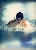 pic of swim meet  - Professional male swimmer swimming in the pool - JPG