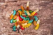 stock photo of gummy bear  - gummy bears candy assorted on a dark background - JPG