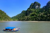 stock photo of langkawi  - Tourist boats at Island of the Pregnant Maiden lake Marble Geoforest Park Langkawi Malaysia - JPG
