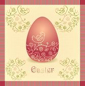 Easter egg with hand drawing beige dark red color