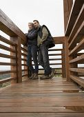 Woman and man on wooden viewpoint