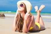picture of boracay  - long haired happy young woman in bikini smiling on tropical Boracay beach