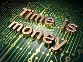 Time concept: Time is Money on circuit board background