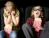 stock photo of watching movie  - Frightened Boy and Girl Wearing New Style 3 - JPG