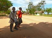 Lindi, Tanzania - Desember 2, 2008: Two Unfamiliar Boys Cross The Road.