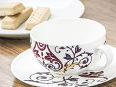 stock photo of shortbread  - Decorative empty coffee cup and shortbread biscuits - JPG