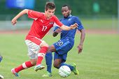 TRAISKIRCHEN, AUSTRIA - JUNE 10 Thomas Murg (#17 Austria) and Lenny Nangis (#10 France) fight for th