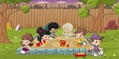 Cute happy cartoon kids playing in sandbox on the backyard