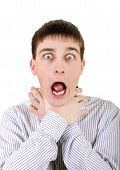 foto of strangle  - Nervous Teenager strangle himself Isolated on the White Background - JPG