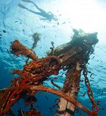 stock photo of bottomless  - Underwater shot of the ship wreck with snorkeler - JPG