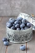 Fresh Blueberries In Small Delicate Metal Casket On Wooden Background