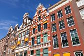 Colorful Houses Facades In Sunny Day Above Blue Sky. Amsterdam