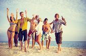stock photo of spring break  - Group of people partying on the beach - JPG