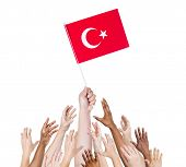 Multi-Ethnic Arms Raised for the Flag of Turkey