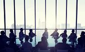People in business meeting infront of New York city skyline.