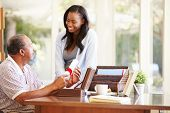 stock photo of keepsake  - Senior Father Discussing Document With Adult Daughter - JPG