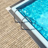 Swimming pool with wooden deck and metal stair