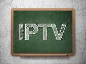 Web development concept: IPTV on chalkboard background