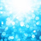 Blurred Blue Vector Background With Sun rays and bokeh