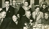 LODZ, POLAND, CIRCA 1950's: Vintage photo of people parting during family dinner