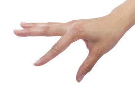 stock photo of verbs  - close up of female human hand flicking for composites - JPG