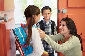 stock photo of say goodbye  - Mother Saying Goodbye To Children As They Leave For School - JPG