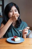 Young Woman Enjoy With A Cake In Cafe