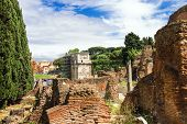 Picturesque Ruins On The Background Of Arches Of Constantine In Rome, Italy