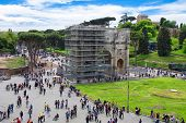 Tourists In Square Near The Triumphal Arch Of Constantine In Rome, Italy