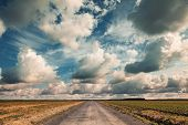 Empty Country Road With Dramatic Cloudy Sky. Vintage Toned Effect