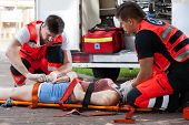 Senseless Woman Lying On Stretcher