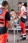 Paramedics Taking Unconscious Girl To Hospital