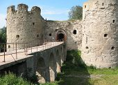 Towers of the medieval fortress in Koporje. Russia poster
